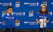 Crespo Elementary School 4th graders Jose Barajan, left, and Alyssa Martinez, right, introduce NBA legends and volunteers from BBVA Compass to students during financial education and success program, February 27, 2014.