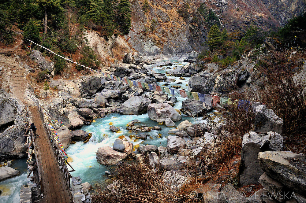 Nepal, himalayas. Wooden bridge over the mountain river in Himalayas.