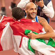 TOKYO, JAPAN August 1:  Lamont Marcell Jacobs of Italy celebrates after winning the 100m Final hugs Andre de Grasse of Canada who won the bronze medal during the Track and Field competition at the Olympic Stadium  at the Tokyo 2020 Summer Olympic Games on July 31, 2021 in Tokyo, Japan. (Photo by Tim Clayton/Corbis via Getty Images)
