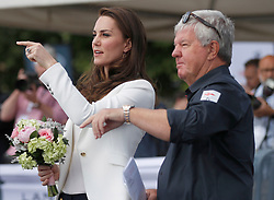 The Duchess of Cambridge is welcomed by Sir Keith Mills as she arrives at the 1851 Trust charity's final Land Rover BAR Roadshow at Docklands Sailing and Watersports Centre in London.
