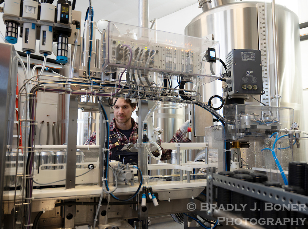 Andrew Perez works the canning apparatus while packaging the first batch of Highpoint cider last month.