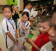 Students from the Dalian (China) Mingxing Primary School visit Dogan Elementary School, July 11, 2016.