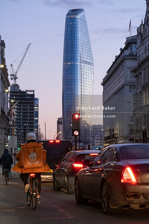Seen from the City of London, One Blackfriars (one of the capital's newest skyscrapers) rises above evening rush-hour traffic, on 26th February 2021, in London, England. Located on Bankside, the south bank of the river Thames, the development is a 52-storey 170m tower whose uses include residential flats, a hotel and retail.
