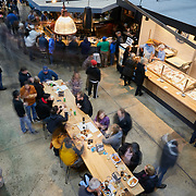 RALEIGH, NC - FEBRUARY 23: Customers sit at a communal table and eat lunch inside Transfer Co. Food Hall  on February 23, 2019 in Raleigh, NC. (Logan Cyrus for The New York Times)