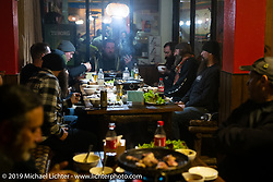 Enjoying a huge cook it at the table dinner at our hotel in Muktinath during Motorcycle Sherpa's Ride to the Heavens motorcycle adventure in the Himalayas of Nepal. On the fourth day of riding, we went from Kalopani to Muktinath. Thursday, November 7, 2019. Photography ©2019 Michael Lichter.