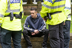 © Licensed to London News Pictures . FILE PICTURE DATED 16/09/2018. Manchester, UK. Police detain JOSEPH BROGAN , in Cathedral Gardens , after he was heard shouting anti-Semitic abuse at a demonstration against antisemitism . Today (14th November 2018) Brogan has been handed a six month sentence for a racially aggravated public order offence after being seen performing a Nazi salute and shouting abuse at Jewish people at the demonstration . Photo credit : Joel Goodman/LNP<br /> <br /> For more information see https://www.manchestereveningnews.co.uk/news/greater-manchester-news/moment-racist-yob-arrested-after-15416089