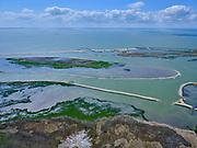 Nederland, Flevoland, Markermeer, 07-05-2021; Marker Wadden in het Markermeer. Gezien naar havenkom. Doel van het project van Natuurmonumenten en Rijkswaterstaat is natuurherstel, met name verbetering van de ecologie in het gebied, in het bijzonder de kwaliteit van bodem en water. De Marker Wadden archipel bestaat momenteel uit vijf eilanden, twee nieuwe eilanden zijn in ontwikkeling.<br /> Marker Wadden, artifial islands. The aim of the project is to restore the ecology in the area, in particular the quality of soil and water.<br /> The Marker Wadden archipelago currently consists of five islands, two new islands are under development.<br /> luchtfoto (toeslag op standard tarieven);<br /> aerial photo (additional fee required)<br /> copyright © 2021 foto/photo Siebe Swart