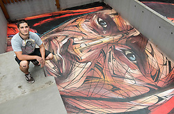 November 10, 2016 - Hong Kong, Hong Kong S.A.R, China - Rooftop painting by Parisian street artist Alexandre Monteiro aka Hopare (pictured)of Masai warrior Daniel Ole Sambu, .Street art in Hong Kong ahead of the The √íHope for Wildlife√ì Gala Dinner painted to raise awareness for the plight of endangered animals the world over..Sheung Wan Hong Kong.10th November 2016. Photo by Jayne Russell. (Credit Image: © Jayne Russell via ZUMA Wire)