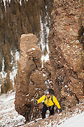 Backcountry skier Judd MacRae ascends the loose talus slopes of Hayden Peak, San Juan Mountains, Colorado.