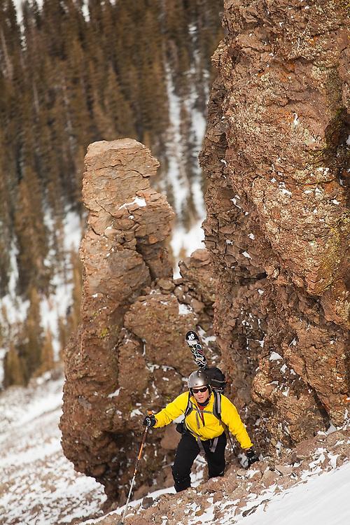 Backcountry skier Judd MacRae ascends the loose talus slopes of Hayden Peak, San Juan Mountains, Colorado.