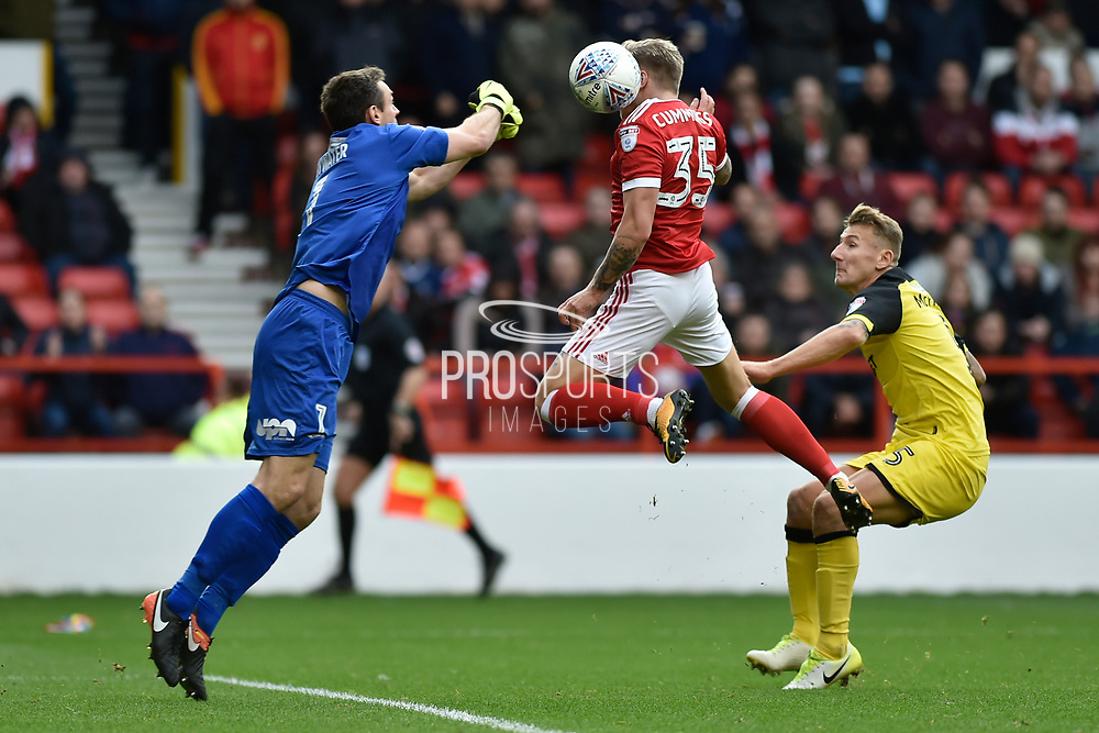 Nottingham Forest striker Jason Cummings (35) head the ball whilst Burton Albion goalkeeper Stephen Bywater (1) attempts to punch the ball clear during the EFL Sky Bet Championship match between Nottingham Forest and Burton Albion at the City Ground, Nottingham, England on 21 October 2017. Photo by Richard Holmes.