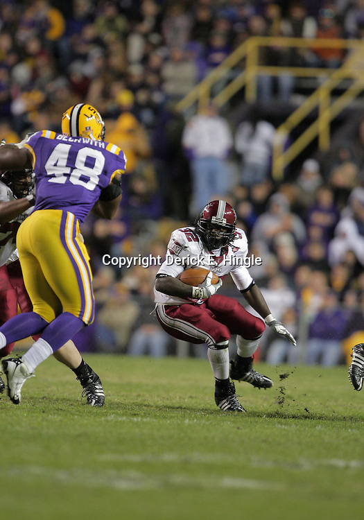 15 November 2008: Troy running back DuJuan Harris (32) tries to avoid LSU defender Darry Beckwith (48) during the first half of the NCAA football game between the Troy Trojans and the LSU Tigers at Tiger Stadium in Baton Rouge, LA.