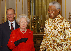 Britain's Queen Elizabeth II and the Duke of Edinburgh (left) meet former South African President, Nelson Mandela during a reception at Buckingham Palace, London, to mark the centenary of the Rhodes Trust, started by the 19th century entrepreneur, Cecil John Rhodes, which provides scholarships for students around the world to study at Oxford University.  The former President of South Africa has entered into partnership with the Rhodes Trust, in its centenary year, to establish the Mandela Rhodes Foundation. At present, 93 scholars are selected from 24 countries each year for study at Oxford University.