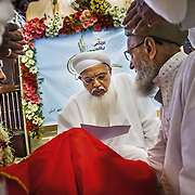 His Holiness, Syedna Mufaddal Saifuddin, heir of the late spiritual leader of the Dawoodi Bohra community Dr. Syedna Mohammed Burhanuddin, conducts the mass wedding at the big Dawoodi Bohra masjid at Mumbai's Bhendi Bazaar. According to the Muslim tradition, the bride sits away while the agreement is made between the groom and the father of the bride.