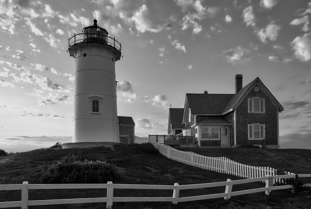 New England Black and White photography of Nobska Lighthouse at sunset. This iconic Massachusetts lighthouse is located near Woods Hole Village in Falmouth, MA on Cape Cod.<br /> <br /> This beautiful B&W Cape Cod lighthouse photography image is available as museum quality photography prints, canvas prints, acrylic prints, wood prints or metal prints. Fine art prints may be framed and matted to the individual liking and interior design decorating needs:<br /> <br /> https://juergen-roth.pixels.com/featured/cape-cod-black-and-white-photography-of-nobska-light-juergen-roth.html<br /> <br /> Good light and happy photo making!<br /> <br /> My best,<br /> <br /> Juergen<br /> Photo Prints: http://www.rothgalleries.com<br /> Photo Blog: http://whereintheworldisjuergen.blogspot.com<br /> Instagram: https://www.instagram.com/rothgalleries<br /> Twitter: https://twitter.com/naturefineart<br /> Facebook: https://www.facebook.com/naturefineart