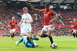 30th April 2017 - Premier League - Manchester United v Swansea City - Swansea goalkeeper Lukasz Fabianski brings down Marcus Rashford of Man Utd to concede a penalty - Photo: Simon Stacpoole / Offside.