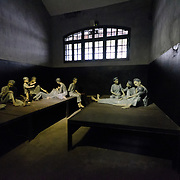 Sculptured figures are used to demonstrate the conditions for female prisoners at Hoa Lo Prison under French colonial rule. Hoa Lo Prison, also known sarcastically as the Hanoi Hilton during the Vietnam War, was originally a French colonial prison for political prisoners and then a North Vietnamese prison for prisoners of war. It is especially famous for being the jail used for American pilots shot down during the Vietnam War.