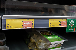 © Licensed to London News Pictures. 09/10/2021. London, UK. 'Sorry temporarily out of stock' label on display on the Morrisons Tandoor Chicken Breast Fillets shelf in Morrisons, north London amid fears of shortage of essential items leading up to Christmas due to labour shortages following Brexit. According to figures from the Office of National Statistics, one in six people in the UK have been unable to buy essential foods in the past two weeks and the Army could be drafted in to drive HGVs over Christmas as the supply chain crisis continues. Photo credit: Dinendra Haria/LNP