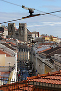 The the ancient romanesque cathedral of Lisbon, seen beneath the typical streets of downtown neighborhoods.