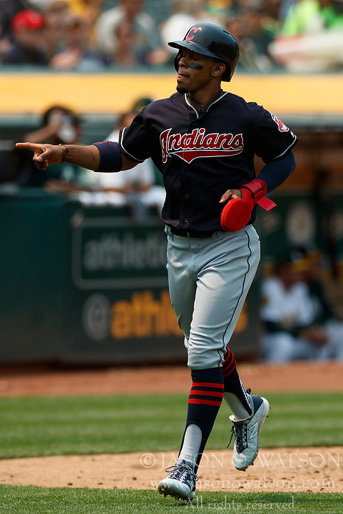 OAKLAND, CA - JULY 01: Francisco Lindor #12 of the Cleveland Indians celebrates after scoring a run against the Oakland Athletics during the fifth inning at the Oakland Coliseum on July 1, 2018 in Oakland, California. The Cleveland Indians defeated the Oakland Athletics 15-3. (Photo by Jason O. Watson/Getty Images) *** Local Caption *** Francisco Lindor