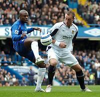 Photo: Ed Godden.<br />Chelsea v West Ham United. The Barclays Premiership. 09/04/2006. Claude Makalele (L) is challenged by West Ham's Dean Ashton (R)