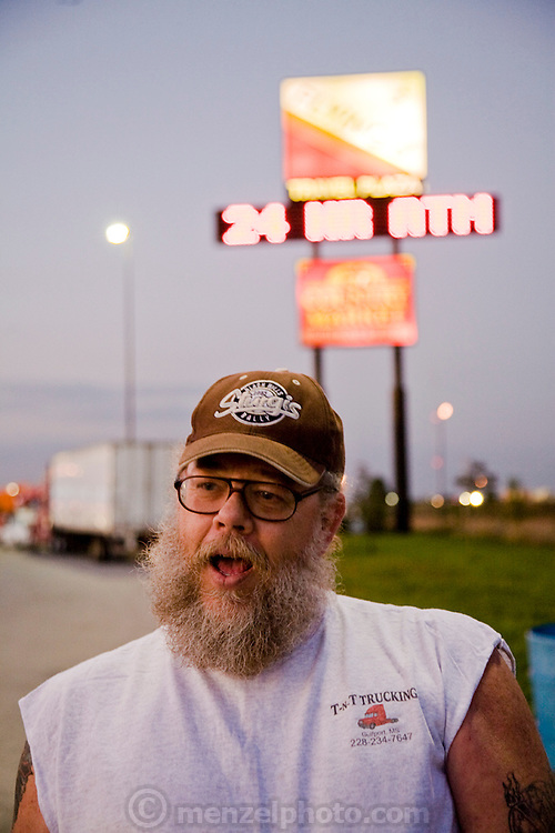 Truck driver and former biker Conrad Tolby at a truck stop at the intersection of I-70 and I-57 in Effingham, Illinois. (Conrad Tolby is featured in the book What I Eat: Around the World in 80 Diets.) MODEL RELEASED.