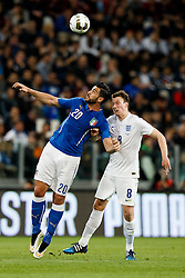 Graziano Pelle of Italy and Phil Jones of England compete in the air - Photo mandatory by-line: Rogan Thomson/JMP - 07966 386802 - 31/03/2015 - SPORT - FOOTBALL - Turin, Italy - Juventus Stadium - Italy v England - FIFA International Friendly Match.