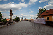 An unusual empty Charles Bridge without tourists which is a historic bridge that crosses the Vltava river in Prague and one of the main attractions in the city. Its construction started in 1357 under the auspices of King Charles IV and finished in the beginning of the 15th century. The Czech government lowered the security measures and as of Monday 25 May 2020, wearing of protective masks will be mandatory only in the interiors of buildings other than the place of residence and in public transport.