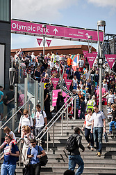 © Licensed to London News Pictures.03/08/2012. London UK. Athletics Fans leaving Olympic Stadium via Westfield after first morning of track and field events.  Photo credit : Andrew Baker/LNP