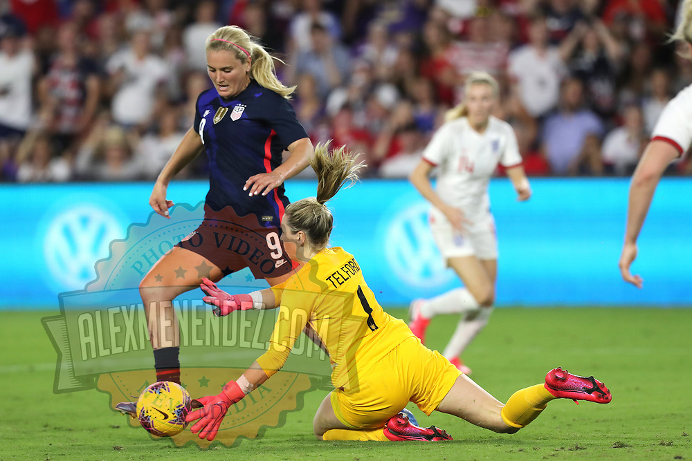 England goalkeeper Carly Telford (1) stops the ball by the United States midfielder Lindsey Horan (9) during the first match of the 2020 She Believes Cup soccer tournament at Exploria Stadium on 5 March 2020 in Orlando, Florida USA.