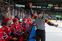 KELOWNA, BC - JANUARY 31: Referee Brayden Arcand speaks to Leif Mattson #28 of the Spokane Chiefs' at the bench against the Kelowna Rockets at Prospera Place on January 31, 2020 in Kelowna, Canada. (Photo by Marissa Baecker/Shoot the Breeze)