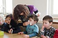 """Nederland, Herpen, 20090128...Begeleidster snuit de neus van een jongentje..Kinderopvang 'Op de boerderij' in Herpen...""""OP DE BOERDERIJ"""" kinderopvang..is gevestigd bij een vleesveebedrijf te Herpen.......Netherlands, Herpen, 20090128. ..Childcare on the farm in Herpen. ..""""ON THE FARM"""" childcare ..is located at a beef farm in Herpen.    ..Supervisor muzzle the nose of a boy"""