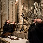 Two monks are extinguishing candles after a low mass at the abbey of Solesmes - 08-01-16.<br /> Deux moines de l'abbaye de Solesmes éteignent des cierges après une messe basse le 08-01-16.