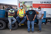 Water Warriors Leon Curley, Zoel Zohnnie, CB Barton and Aaron Wood pose for a portrait after a day's work of hauling water at Navajo Technical University in Crownpoint, New Mexico.