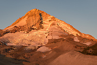 The first light of the day illuminates the north face of Mount Hood. The Eliot Glacier is the largest in Oregon.