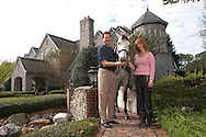 Former Major League Baseball pitcher Frank Viola, left, and his wife Kathy stand with one of their horses in front of their waterfront home in Orlando, Florida.  Viola is a former World Series MVP and Cy Young Award winner.