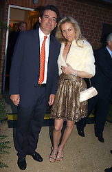 MR NICK BARHAM and SABINA MCTAGGART at the Cartier Chelsea Flower Show dinat the annual Cartier Flower Show Diner held at The Physics Garden, Chelsea, London on 23rd May 2005.<br /><br />NON EXCLUSIVE - WORLD RIGHTS