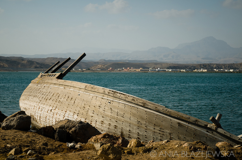 Oman, Sur. An old traditional dhow (a kind of a boat used in Oman) abandoned at the beach.