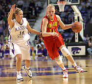 Iowa State forward Megan Ronhovde (R) brings the ball up court against pressure from Kansas State's Clair Coggins (L) in the first half at Bramlage Coliseum in Manhattan, Kansas, February 11, 2006.  The Cyclones defeated the Wildcats 71-66.