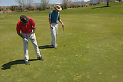 Two golfers assess a shot, Taos Country Club