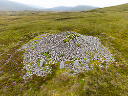 Aerial view from drone of neolithic chambered cairn at Reineval on South Uist, Outer Hebrides, Scotland, UK