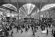 Rush hour at Liverpool Street station. Before modernisation in 1985. It is one of the busiest commuter stations in London and was built as a dual-level station with an underground station opened in 1875 for the Metropolitan Railway, named Bishopsgate until 1909 when it was renamed Liverpool Street. Coming and Going is a project commissioned by the Museum of London for photographer Barry Lewis in 1976 to document the transport system as it is used by passengers and commuters using public transport by trains, tubes and buses in London, UK.