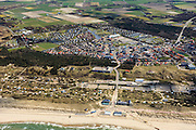 Nederland, Noord-Holland, Texel, 16-04-2012; De Koog, strandopgang en Badhotel.Entrance to the beach of the Northsea and hotel in the dunes of the isle of Texel. The village of De Koog in the back..luchtfoto (toeslag), aerial photo (additional fee required);.copyright foto/photo Siebe Swart
