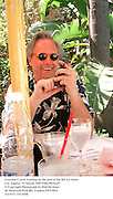 Graydon Carter working by the pool at the Bel Air hotel. Los Angeles. 22 March 1998 Film 98161af7<br />© Copyright Photograph by Dafydd Jones<br />66 Stockwell Park Rd. London SW9 0DA<br />Tel 0171 733 0108
