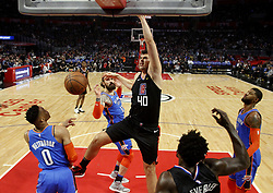 March 8, 2019 - Los Angeles, California, U.S - Los Angeles Clippers' Ivica Zubac (40) dunks during an NBA basketball game between Los Angeles Clippers and Oklahoma City Thunder Friday, March 8, 2019, in Los Angeles. (Credit Image: © Ringo Chiu/ZUMA Wire)