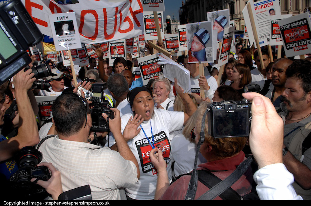 London 20/09/08: The People's March against knife crime: Gemma Olway, one of the event's organisers, pleads with the press to create space, when murdered schoolboy Damilola Taylor's father Richard greeted families from the 'North March'.