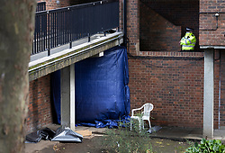 © Licensed to London News Pictures. 06/07/2021. London, UK. Plastic sheeting covers part of a crime scene (L) at a housing estate off Oval Place in south London where a 16 year old boy was stabbed to death last night. Police were called at around 23:45hrs on Monday, 5 July, to a teenager stabbed in Oval Place, SW8. Officers attended along with London Ambulance Service. The 16-year-old male was pronounced dead at the scene. Photo credit: Peter Macdiarmid/LNP