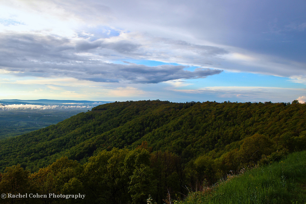"""""""Passing Storm on the Ridge""""<br /> <br /> Enjoy the green of the forests in the Blue Ridge Mountains of Virginia. Observe the low clouds in the distance, and the passing storm clouds above!!<br /> <br /> The Blue Ridge Mountains by Rachel Cohen"""