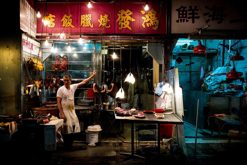Hong Kong, China - A butcher waits for customers at a shop selling fresh meats at a street market in the Wan Chai district of Hong Kong on April 29,  2018.Hong Kong, Chine - Le 29 avril 2018, un boucher attend ses clients dans un magasin de viandes fraîches d'un marché de rue du quartier Wan Chai de Hong Kong.