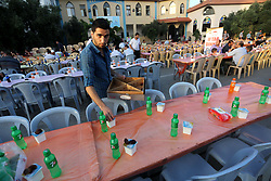 June 12, 2017 - Gaza City, Gaza Strip, Palestinian Territory - Palestinian Muslims eat their Iftar meal as they break their fast during the holy fasting month of Ramadan, in Gaza city on June 8, 2017. Ramadan is sacred to Muslims because it is during that month that tradition says the Koran was revealed to the Prophet Mohammed. The fast is one of the five main religious obligations under Islam. More than 1.5 billion Muslims around the world will mark the month, during which believers abstain from eating, drinking, smoking and having sex from dawn until sunset  (Credit Image: © Mohammed Asad/APA Images via ZUMA Wire)
